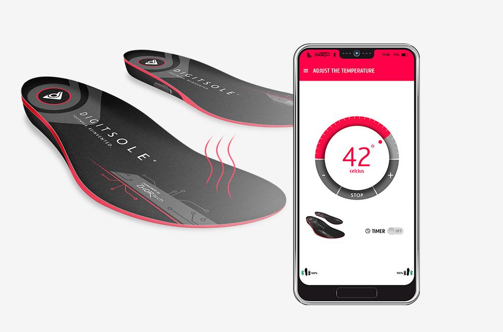 Heizsohlen von Digitsole. Auf dem Smartphone ist die Einstellung zur Temperaturregulierung abgebildet